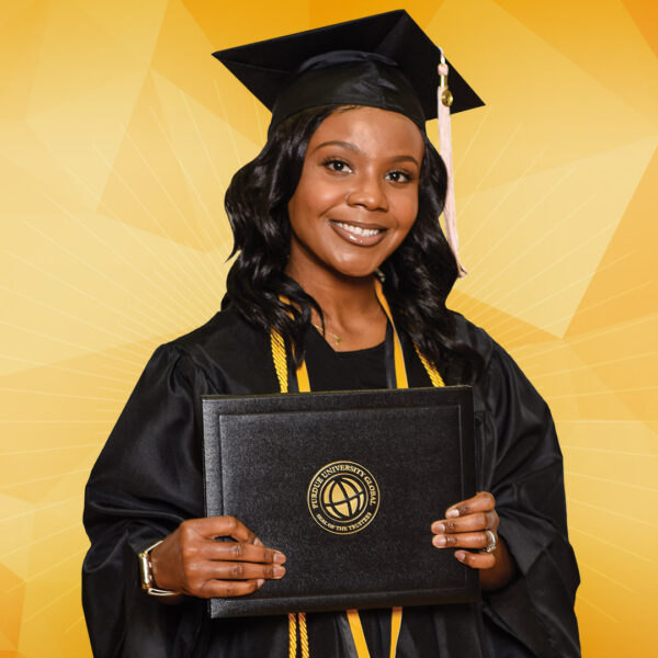 a black female purdue global graduate dressed in cap and gown holding her diploma