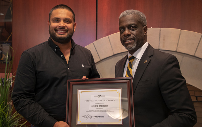 Rudra Sharirm awarded plaque by Purdue Alumni CEO Ralph Amos