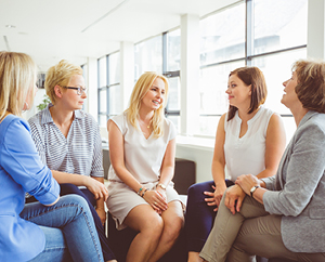 five women sitting and talking