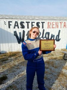 Kait Hauber holds a racing award