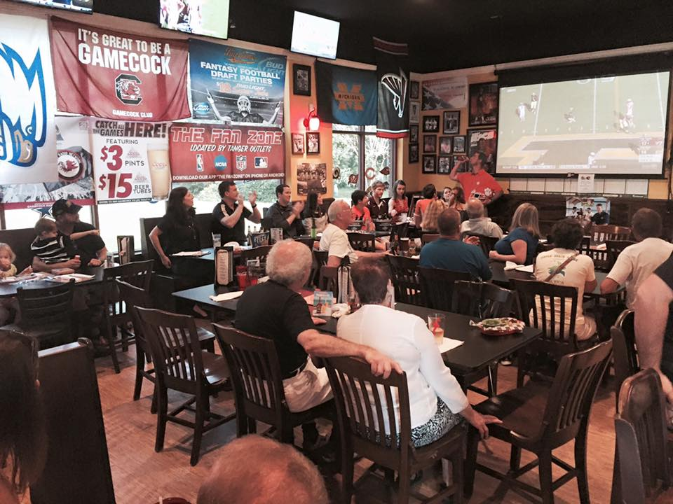 people in restaurant watching a football game