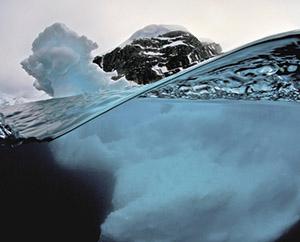 iceberg half above water and half below water