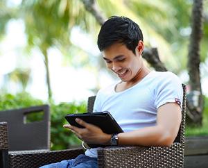 man using tablet outside