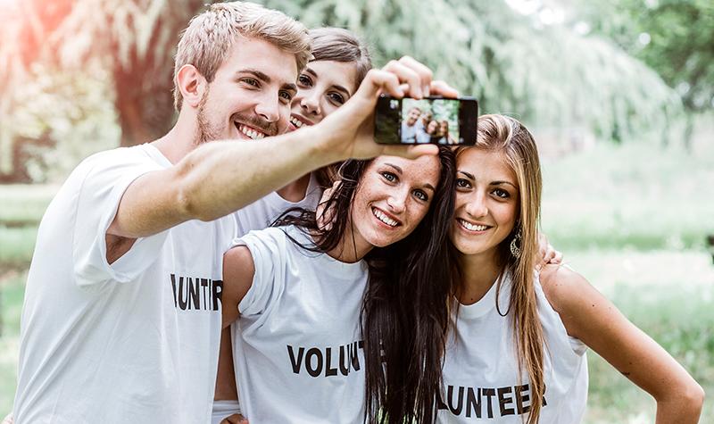 Four volunteers taking a selfie
